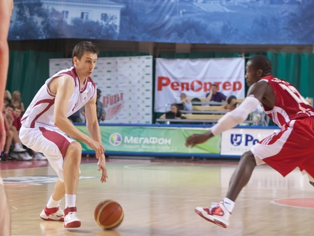 pbl: SAMARA, RUSSIA - JUNE 14: Artem Kuzyakin of BC Krasnye Krylia, with ball, is on the attack during a BC Spartak game on June 14, 2011 in Samara, Russia.