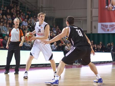 SAMARA, RUSSIA - OCTOBER 20: Kolesnikov Evgeny of BC Krasnye Krylia with ball tries to go past a BC Nizhny Novgorod player on October 20, 2010 in Samara, Russia. Stock Photo - 10986566