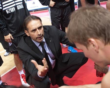 bc krasnye krylia samara: SAMARA, RUSSIA - OCTOBER 20: Time out. Coach of BC Nizhny Novgorod Zoran Lukic says the game plan against BC Krasnye Krylia on October 20, 2010 in Samara, Russia.