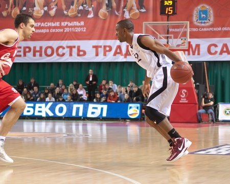 pbl: SAMARA, RUSSIA - NOVEMBER 25: Miles Aaron Marquez of BC Krasnye Krylia with ball goes against a BC Spartak player on November 25, 2011 in Samara, Russia. Editorial