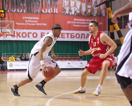 pbl: SAMARA, RUSSIA - NOVEMBER 25: Brion Rush of BC Krasnye Krylia with ball tries to go past a BC Spartak player on November 25, 2011 in Samara, Russia. Editorial