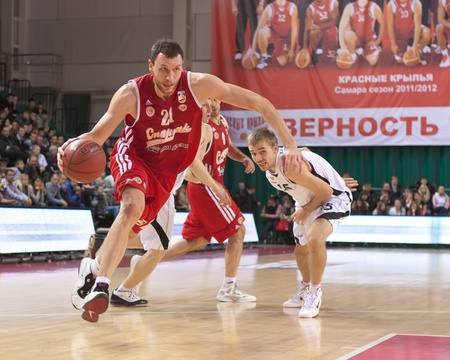 pbl: SAMARA, RUSSIA - NOVEMBER 25: Loukas Mavrokefalidis of BC Spartak, with ball, is on the attack during a BC Krasnye Krylia game on November 25, 2011 in Samara, Russia.