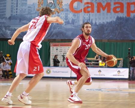 nesterov: SAMARA, RUSSIA - NOVEMBER 9: Alexander Joseph Anthony of BC Krasnye Krylia with ball goes against a BC Ryazan player on November 9, 2011 in Samara, Russia. Editorial
