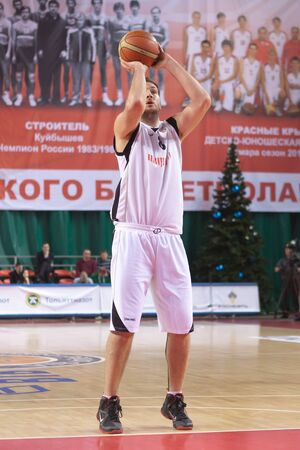 bc vef riga: SAMARA, RUSSIA - DECEMBER 23: Dragan Labovic of BC Krasnye Krylia throw from the free throw line in a game against BC VEF on December 23, 2011 in Samara, Russia.