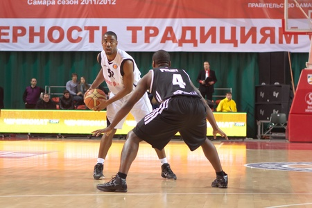 bc vef riga: SAMARA, RUSSIA - DECEMBER 23: Aaron Marquez Miles of BC Krasnye Krylia with ball tries to go past a BC VEF player on December 23, 2011 in Samara, Russia.