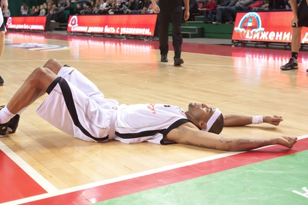 SAMARA, RUSSIA - DECEMBER 23: Brion Rush of BC Krasnye Krylia is on the floor after a foul in a game against BC VEF on December 23, 2011 in Samara, Russia.