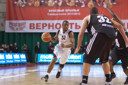bc vef riga: SAMARA, RUSSIA - DECEMBER 23: Aaron Marquez Miles of BC Krasnye Krylia, with ball, is on the attack during a BC VEF game on December 23, 2011 in Samara, Russia.