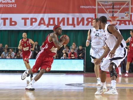 SAMARA, RUSSIA - NOVEMBER 02: Chalmers Lionel of BC Lokomotiv-Kuban, with ball, is on the attack during a BC Krasnye Krylia game on November 02, 2011 in Samara, Russia.