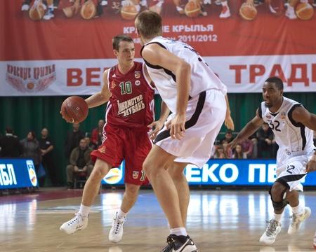 SAMARA, RUSSIA - NOVEMBER 02: Bykov Sergey of BC Lokomotiv-Kuban, with ball, is on the attack during a BC Krasnye Krylia game on November 02, 2011 in Samara, Russia. Editorial