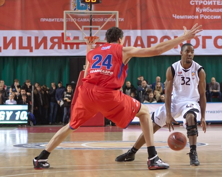 miles aaron marquez: SAMARA, RUSSIA - NOVEMBER 19: Aaron Marquez Miles of BC Krasnye Krylia with ball tries to go past a BC CSKA player on November 19, 2011 in Samara, Russia.
