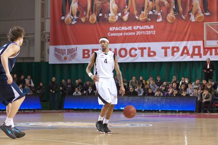 pbl: SAMARA, RUSSIA - JANUARY 28: Brion Rush of BC Krasnye Krylia, with ball, is on the attack during a BC Triumph game on January 28, 2012 in Samara, Russia.