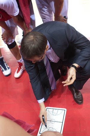 pbl: SAMARA, RUSSIA - JANUARY 28: Time out. Coach of BC Krasnye Krylia Sergey Bazarevich says the game plan against BC Triumph on January 28, 2012 in Samara, Russia.