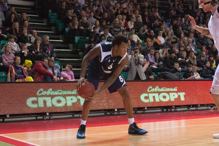 pbl: SAMARA, RUSSIA - JANUARY 28: Davon Jefferson of BC Triumph with ball goes against a BC Krasnye Krylia player on January 28, 2012 in Samara, Russia.