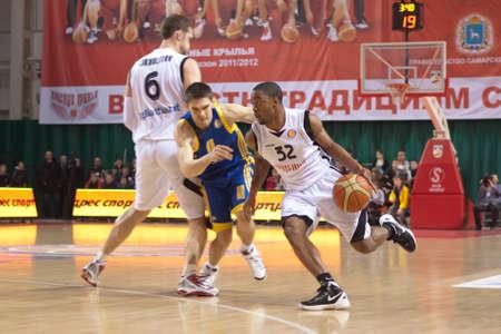 SAMARA, RUSSIA - FEBRUARY 04: Aaron Marquez Miles of BC Krasnye Krylia, with ball, is on the attack during a BC Khimki game on February 04, 2012 in Samara, Russia.