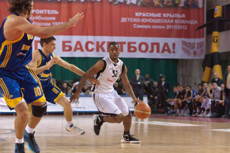 miles aaron marquez: SAMARA, RUSSIA - FEBRUARY 04: Aaron Marquez Miles of BC Krasnye Krylia, with ball, is on the attack during a BC Khimki game on February 04, 2012 in Samara, Russia.