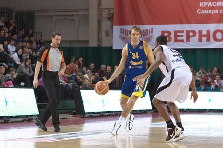 SAMARA, RUSSIA - FEBRUARY 04: Zoran Planinic of BC Khimki with ball tries to go past a BC Krasnye Krylia player on February 04, 2012 in Samara, Russia.