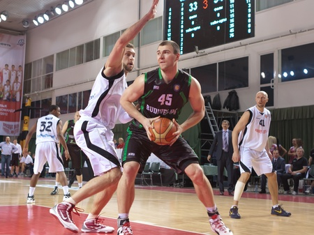 SAMARA, RUSSIA - FEBRUARY 15: Artsiom Parakhouskis of BC Budivelnik with ball tries to go past a BC Krasnye Krylia player on February 15, 2012 in Samara, Russia.