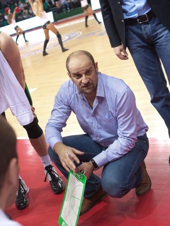 SAMARA, RUSSIA - FEBRUARY 15: Time out. Coach of BC Budivelnik Zvezdan Mitrovic says the game plan against BC Krasnye Krylia on February 15, 2012 in Samara, Russia. Stock Photo - 12779175