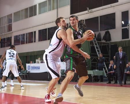 SAMARA, RUSSIA - FEBRUARY 15: Mikhailo Anisimov of BC Budivelnik with ball tries to go past a BC Krasnye Krylia player on February 15, 2012 in Samara, Russia.