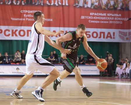 SAMARA, RUSSIA - FEBRUARY 15: Andriy Malysh of BC Budivelnik, with ball, is on the attack during a BC Krasnye Krylia game on February 15, 2012 in Samara, Russia. Stock Photo - 12935899