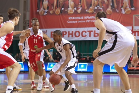 miles aaron marquez: SAMARA, RUSSIA - FEBRUARY 18: Aaron Marquez Miles of BC Krasnye Krylia with ball tries to go past a BC Spartak-Primorye player on February 18, 2012 in Samara, Russia.