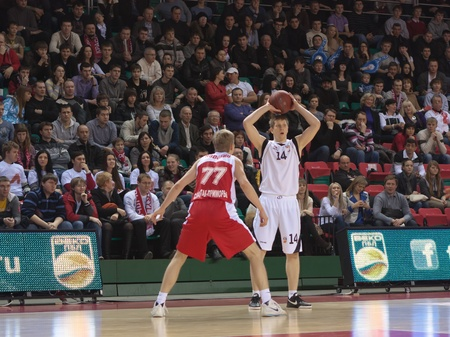 SAMARA, RUSSIA - FEBRUARY 18: Evgeny Kolesnikov of BC Krasnye Krylia, with ball, is on the attack during a BC Spartak-Primorye game on February 18, 2012 in Samara, Russia. Stock Photo - 13073333