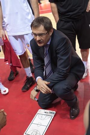 SAMARA, RUSSIA - FEBRUARY 18: Time out. Coach of BC Krasnye Krylia Sergey Bazarevich says the game plan against BC Spartak-Primorye on February 18, 2012 in Samara, Russia. Stock Photo - 13073327