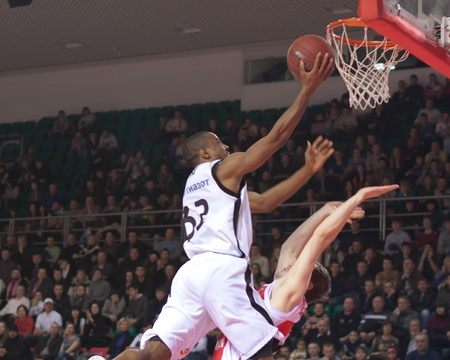 pbl: SAMARA, RUSSIA - FEBRUARY 18: Aaron Marquez Miles of BC Krasnye Krylia throws a ball in a basket during a BC Spartak-Primorye game on February 18, 2012 in Samara, Russia.