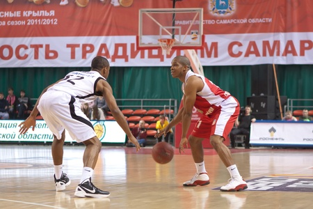 pbl: SAMARA, RUSSIA - FEBRUARY 18: Thomas Torey of BC Spartak-Primorye, with ball, is on the attack during a BC Krasnye Krylia game on February 18, 2012 in Samara, Russia.