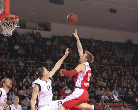 SAMARA, RUSSIA - FEBRUARY 18: Nesterov Konstantin of BC Spartak-Primorye throws a ball in a basket during a BC Krasnye Krylia game on February 18, 2012 in Samara, Russia. Stock Photo - 13456085