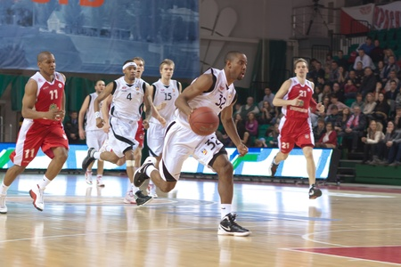 nesterov: SAMARA, RUSSIA - FEBRUARY 18: Aaron Marquez Miles of BC Krasnye Krylia, with ball, is on the attack during a BC Spartak-Primorye game on February 18, 2012 in Samara, Russia.