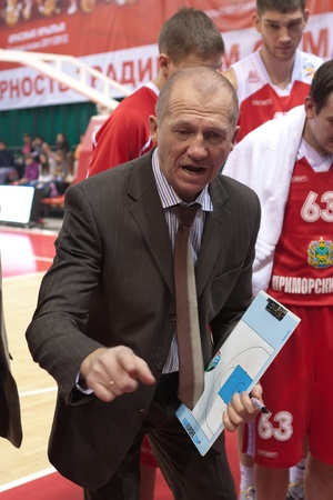 SAMARA, RUSSIA - FEBRUARY 18: Time out. Coach of BC Spartak-Primorye Boris Livanov says the game plan against BC Krasnye Krylia on February 18, 2012 in Samara, Russia. Stock Photo - 13456092