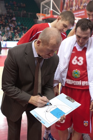 SAMARA, RUSSIA - FEBRUARY 18: Time out. Coach of BC Spartak-Primorye Boris Livanov says the game plan against BC Krasnye Krylia on February 18, 2012 in Samara, Russia. Stock Photo - 13456091