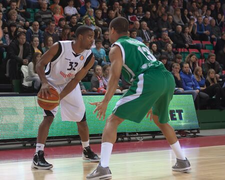miles aaron marquez: SAMARA, RUSSIA - MARCH 10: Aaron Marquez Miles of BC Krasnye Krylia with ball goes against a BC UNICS player on March 10, 2012 in Samara, Russia.