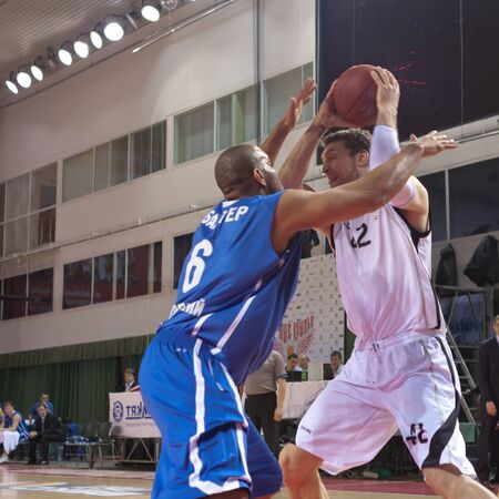 pbl: SAMARA, RUSSIA - MARCH 14: Fedor Likholitov of BC Krasnye Krylia with ball tries to go past a BC Enisey player on March 14, 2012 in Samara, Russia.