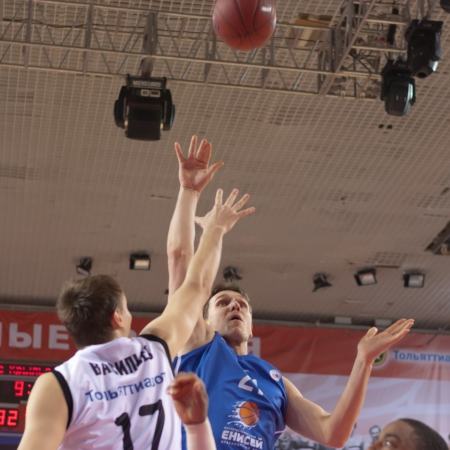 pbl: SAMARA, RUSSIA - MARCH 14: Gromyko Pavel of BC Enisey, with ball, is on the attack during a BC Krasnye Krylia game on March 14, 2012 in Samara, Russia.