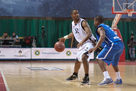 pbl: SAMARA, RUSSIA - MARCH 14: Aaron Marquez Miles of BC Krasnye Krylia with ball tries to go past a BC Enisey player on March 14, 2012 in Samara, Russia. Editorial