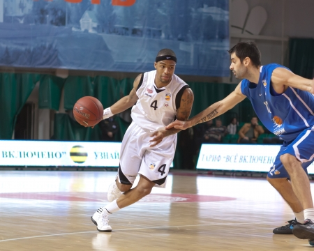 pbl: SAMARA, RUSSIA - MARCH 14: Brion Rush of BC Krasnye Krylia with ball tries to go past a BC Enisey player on March 14, 2012 in Samara, Russia.