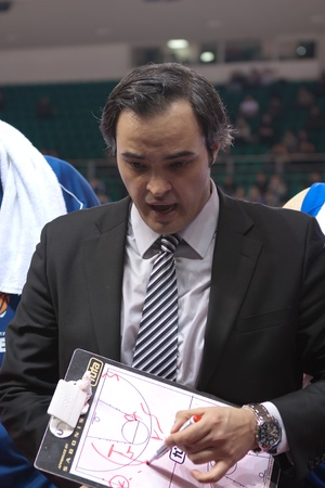 pbl: SAMARA, RUSSIA - MARCH 14: Time out. Coach of BC Enisey Milan Kotaratc says the game plan against BC Krasnye Krylia on March 14, 2012 in Samara, Russia.