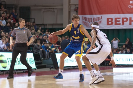 pbl: SAMARA, RUSSIA - APRIL 01: Vyaltsev Egor of BC Khimki with ball goes against a BC Krasnye Krylia player on April 01, 2012 in Samara, Russia.