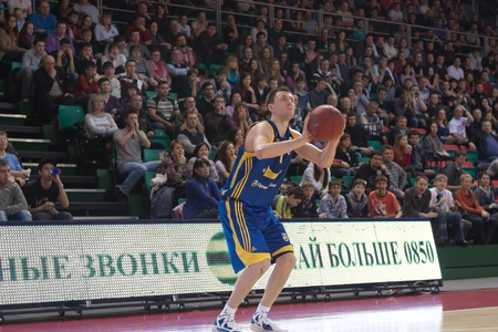 pbl: SAMARA, RUSSIA - APRIL 01: Fridzon Vitaliy of BC Khimki, with ball, is on the attack during a BC Krasnye Krylia game on April 01, 2012 in Samara, Russia.