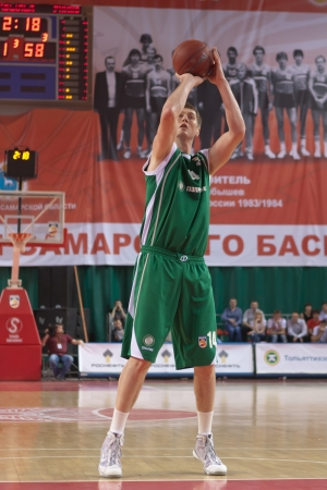 pbl: SAMARA, RUSSIA - APRIL 17: Savrasenko Alexey of BC UNICS throws a ball in a basket during a game against BC Krasnye Krylia on April 17, 2012 in Samara, Russia.