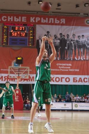 SAMARA, RUSSIA - APRIL 17: Veremeenko Vladimir of BC UNICS throws a ball in a basket during a game against BC Krasnye Krylia on April 17, 2012 in Samara, Russia.