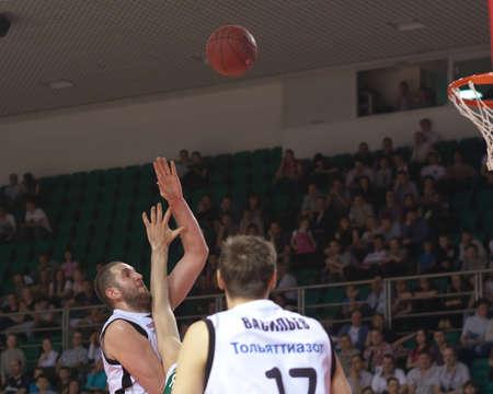 SAMARA, RUSSIA - APRIL 17: Dragan Labovic of BC Krasnye Krylia throws a ball in a basket during a game against BC UNICS on April 17, 2012 in Samara, Russia. Editorial