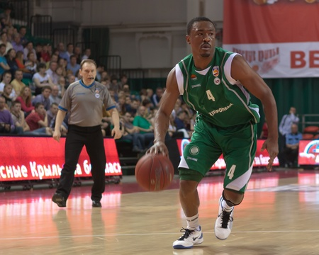 pbl: SAMARA, RUSSIA - APRIL 17: Lyday Terrell of BC UNICS, with ball, is on the attack during a BC Krasnye Krylia game on April 17, 2012 in Samara, Russia. Editorial
