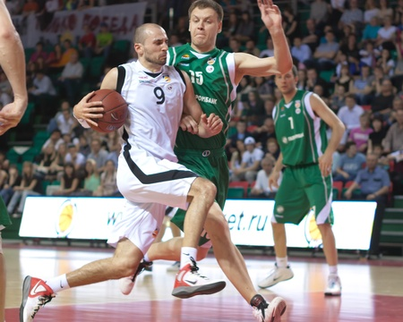 pbl: SAMARA, RUSSIA - APRIL 17: Rolandas Alijevas of BC Krasnye Krylia with ball tries to go past a BC UNICS player on April 17, 2012 in Samara, Russia. Editorial