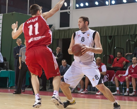 SAMARA, RUSSIA - MAY 03: Dragan Labovic of BC Krasnye Krylia with ball tries to go past a BC Spartak player on May 03, 2012 in Samara, Russia.