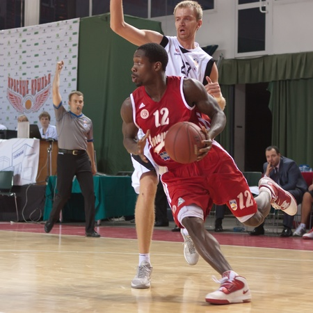 SAMARA, RUSSIA - MAY 03: Patrick Beverley of BC Spartak with ball tries to go past a BC Krasnye Krylia player on May 03, 2012 in Samara, Russia.