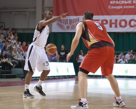 SAMARA, RUSSIA - MAY 11: Aaron Marquez Miles of BC Krasnye Krylia with ball goes against a BC Ural player on May 11, 2012 in Samara, Russia.