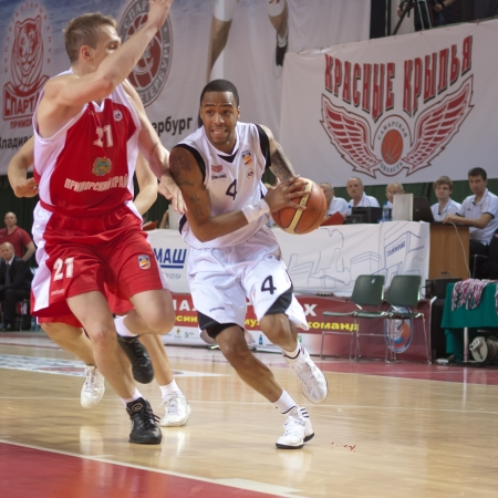 nesterov: SAMARA, RUSSIA - MAY 12: Brion Rush of BC Krasnye Krylia, with ball, is on the attack during a BC Spartak-Primorje game on May 12, 2012 in Samara, Russia. Editorial